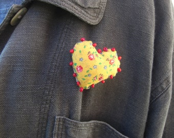 Heart brooch in yellow and red.