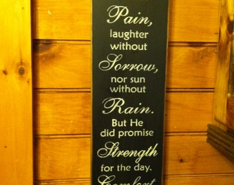 God didn't promise days without pain....vertical sign with saying