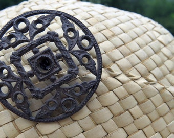Lovely antique hat pin with round filigree top.