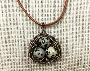 Antique brass birds nest necklace with dalmation jasper beads