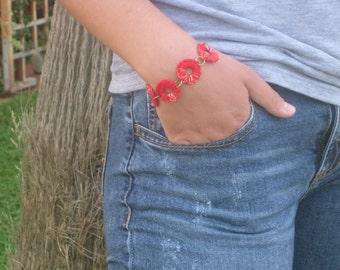 Red crochet ring bracelet.