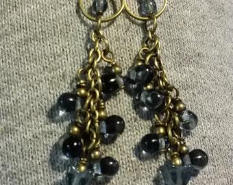 dangling earring; dark blue beads