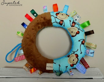 Rustling ring-shaped sensory toy, taggy,