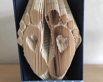 Baby feet with heart book folding pattern