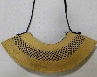 uniquely conceived straw purse with pendulum swing-shape