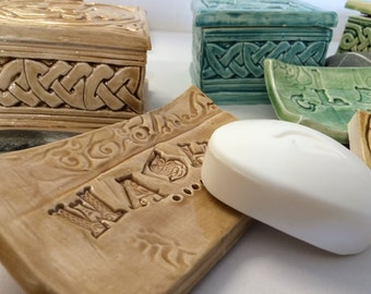 Handmade ceramic soap dish in wheat glaze, with embossed celtic lettering and imprinted pattern.