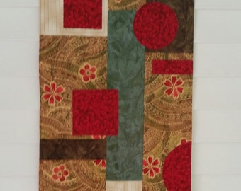Original Abstract quilted wall hanging in rich earth tones with pops of red