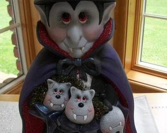 ceramic vampire,dracula holding bats