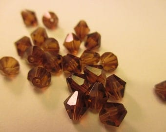 Package of 20 Brown 6mm Czech Glass Bicone Faceted Beads. Item:BC818664