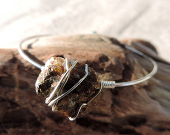 silver bangle with wire wrapped free form chalcopyrite bracelet .