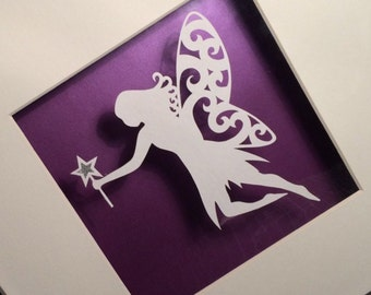 Hand drawn, hand cut, floating fairy papercut