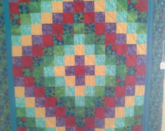 Beautiful Trip Around the World baby quilt or wall hanging. Bold bright colors. Machine pieced & hand quilted.