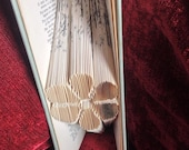 Book folding art pattern for a flower
