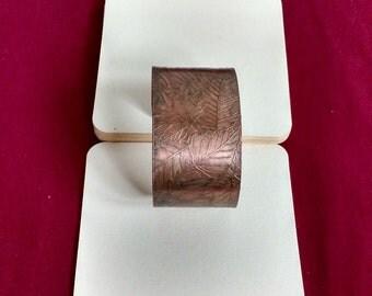 Handmade etched copper cuff bracelet.