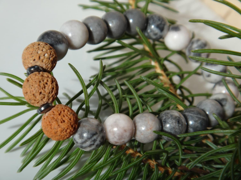 Bracelet diffuseur d 39 huile essentielles pierres de lave - Huile essentielle machine a laver ...