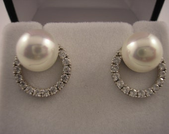 Sterling Silver, Pearl earrings with Cubic Zirconia wreath.