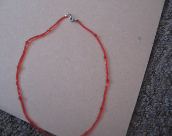 Red small mixed beads necklace.