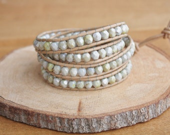 Light green, honey and aqua colored faceted beads on a 4-wrap leather bracelet with adjustable button and loop closure