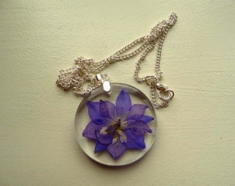Resin pendant with purple larkspur