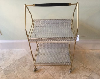 Mid century modern silver and gold beverage cart on casters