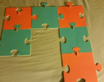 Orange and turquoise puzzle picture holders.
