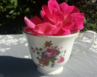 Pink floral tea cup by Royal Winchester.