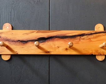 Coat rack from fissured yew