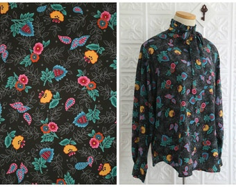 Black, Long Sleeved Button Down Blouse with Ruffled High Collar, Neck Tie and Happy Paisley Print