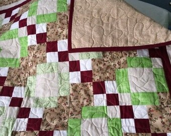 Burgandy quilt throw