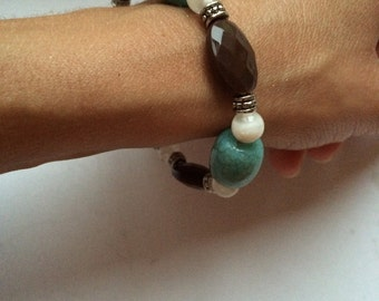 brown and turquoise blue stretch bead bracelet