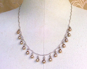 necklace with taupe pearls