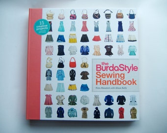 The BurdaStyle Sewing Handbook sewing book with 5 sewing patterns