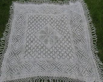 White crochet gossamer downy shawl made of goat down. Shawle with fringe.