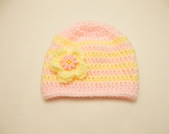Pink and yellow crochet hat for baby girl with coordinating flower and button