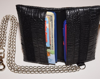 Handcrafted, multi-use, universal fit cell phone and wallet with chains. Made for a variety of cell phones with or without an otterbox.