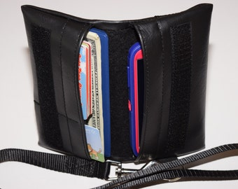 Handcrafted, multi-use, universal fit cell phone and wallet with lanyard.