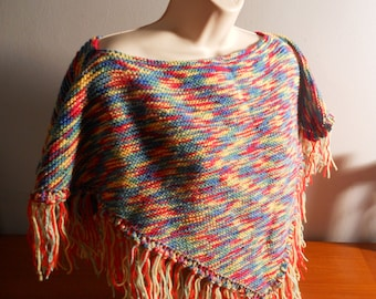 Small hand knitted poncho style shawl made in acrylic yarn for wearing on a cold night in front of the tv or as a bed jacket