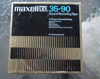 Maxell reel to reel tape 35-90 1800 ft with various classical music on it.