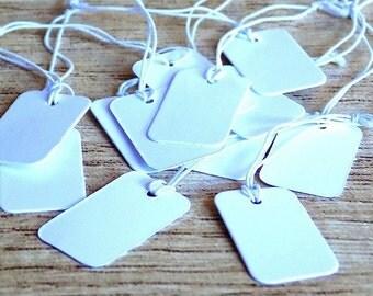 100 X  Etiquettes blanches pour prix dimensions 25x15x0.3 mm