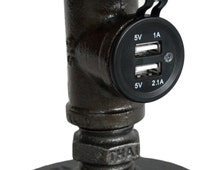 Pipe furniture Style USB charger made from cast pipe fittings. Can charge 2 USB devices at the same time.