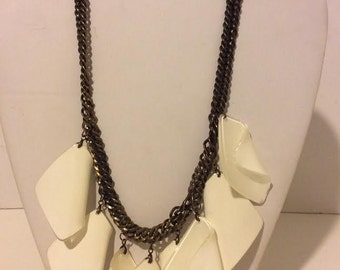 White chunky resin necklace on a bronze chain