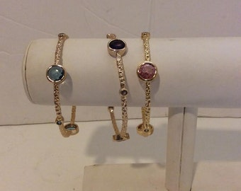 Set of 3 Small round blue purple and pink gold colored bangle bracelets
