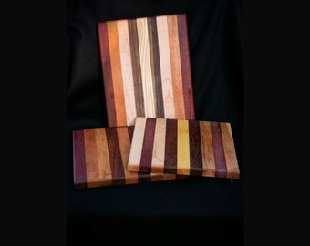 cutting board made from woods from around the world.  Using both domestic and exotic woods in there natural colors