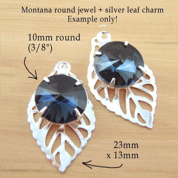 montana sapphire round glass jewel with a silver-plated leaf charm