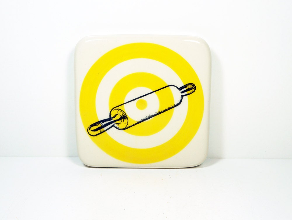 tile with a rolling pin on a yellow bullseye. Made to Order / Pick Your Colour