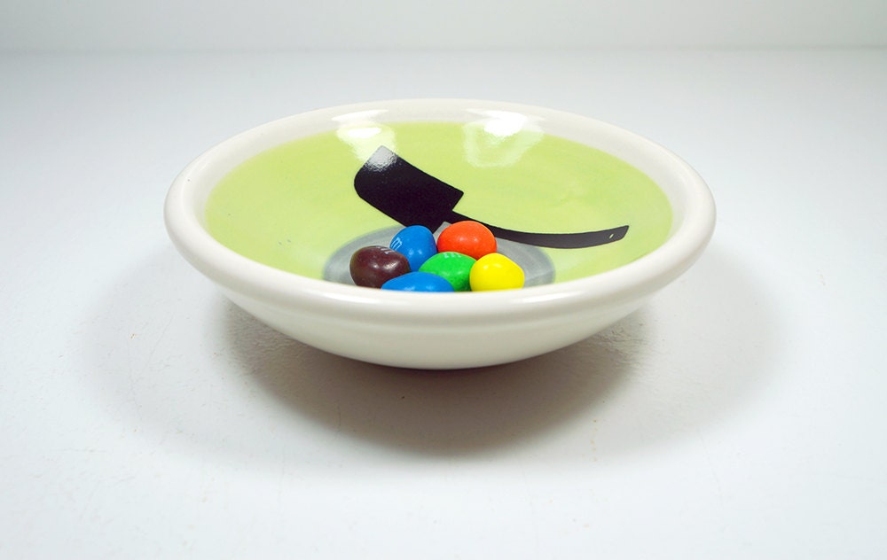 small dish, with a spatula (some call it a scraper spatula) on a color block of tinda & storm, made to order.