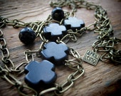 SAFEKEEPING necklace antique brass chain lava obsidian cross ladder