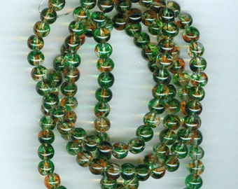 6mm Green and Orange Spotted Glass Round Beads 30in strand