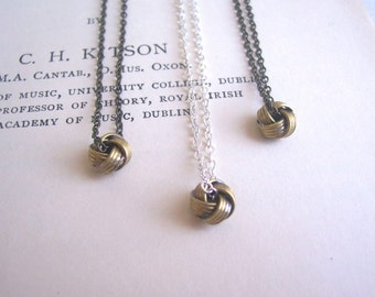 Petite Love Knot charm necklace - brass and silver mixed metal vintage charms - minimal