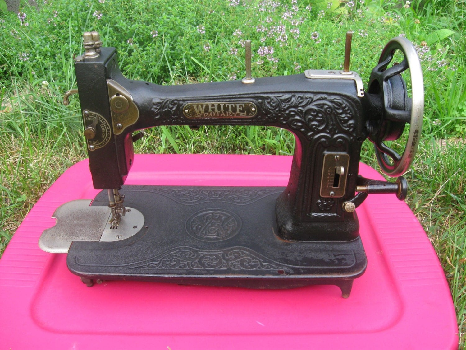 antique white rotary electric sewing machine